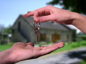 handing over the key to a house