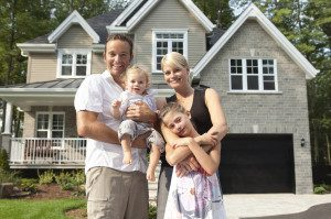 Family-in-front-of-house-300×199.jpg