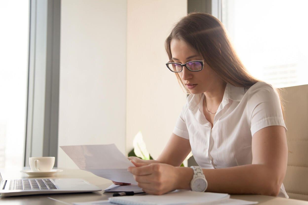 woman looking at paperwork