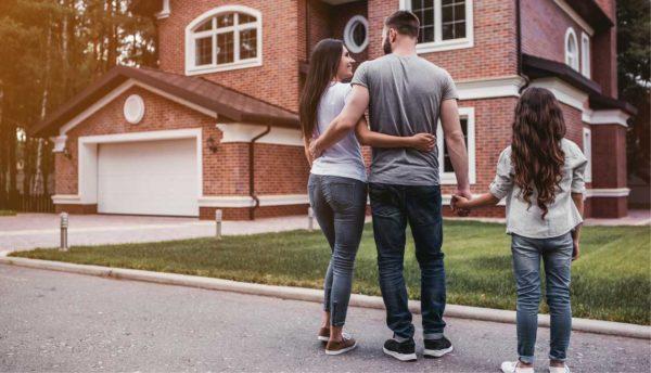 family walking towards a house